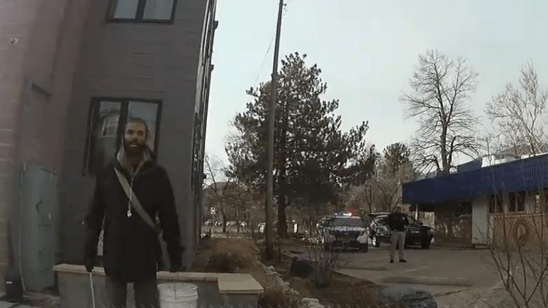 Officer who pulled gun on Black man picking up trash has resigned