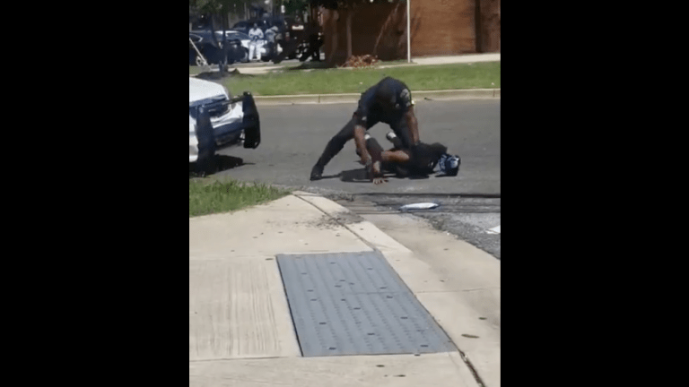 Police Officer Caught on Tape Punching Black Man