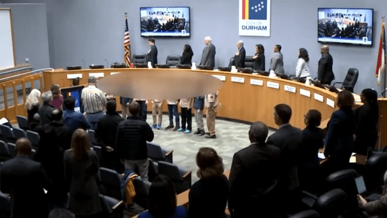 Pic goes viral of 10-year-old kneeling during Pledge of Allegiance