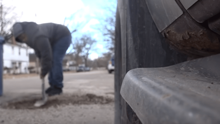 Michigan boy single-handedly fills 15 potholes on his street