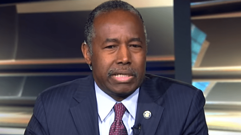 Carson slammed for coughing into hand at news conference